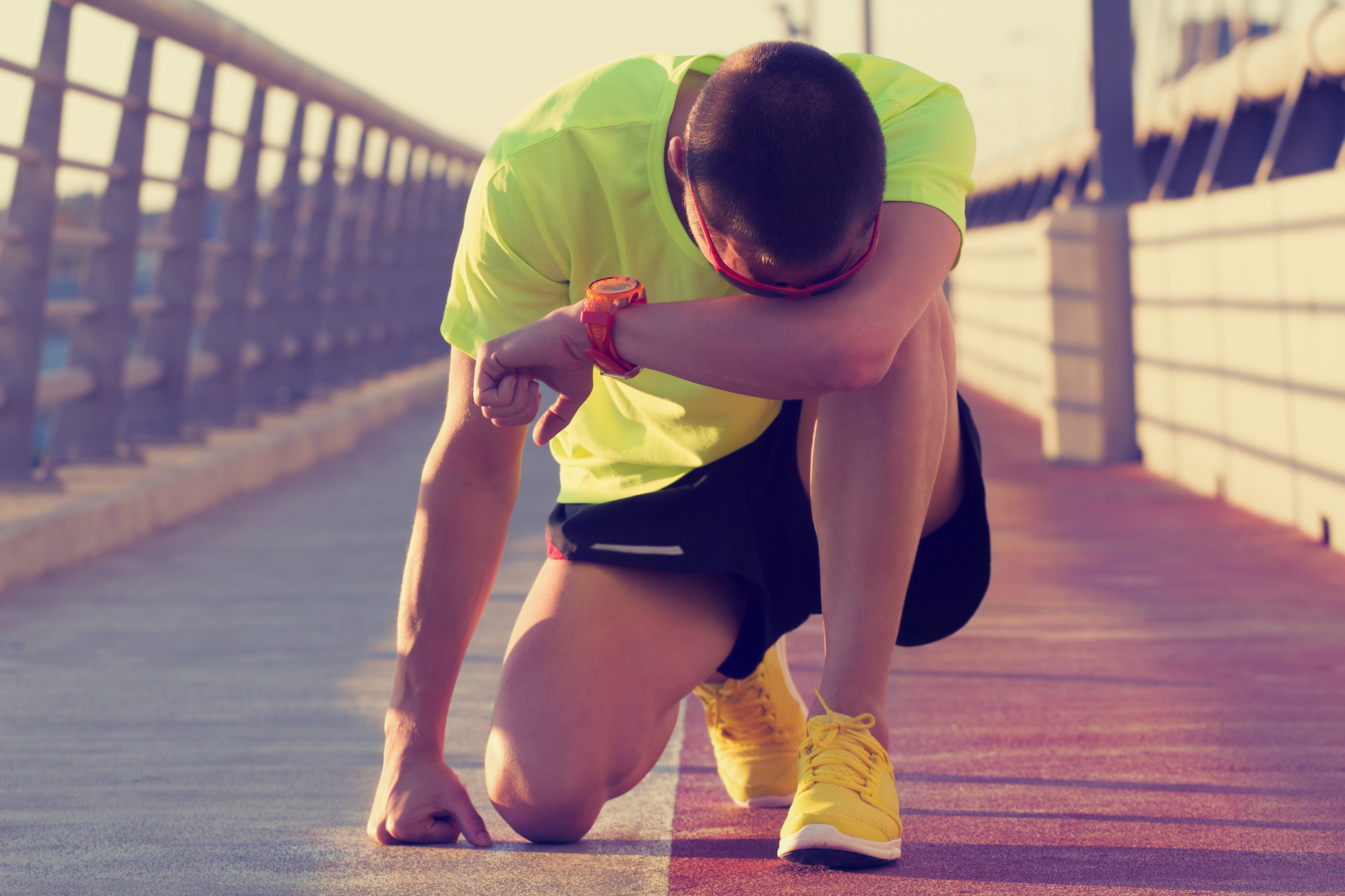 Tired/injured jogger on a big bridge.